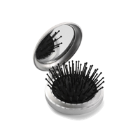 Pocket mirror with brush